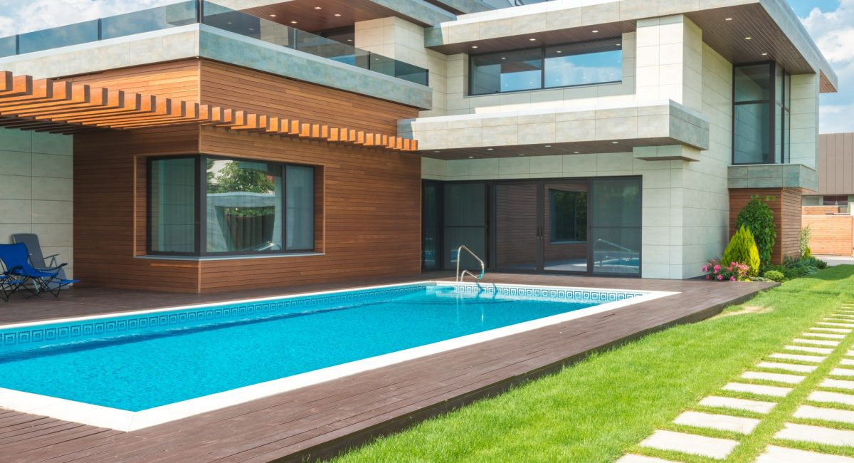 swimming pool in front of a house